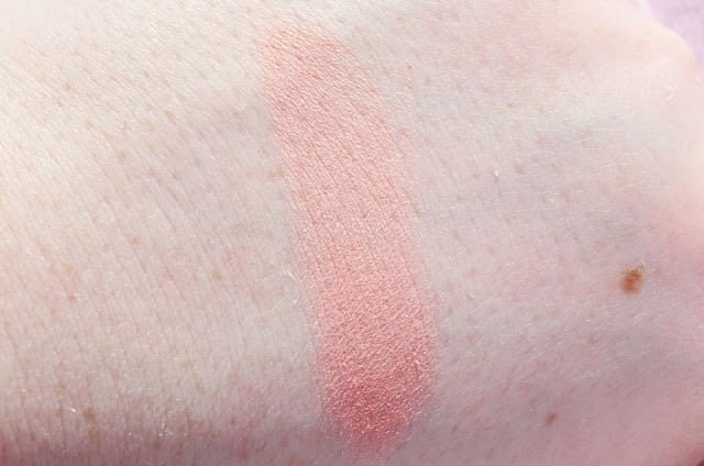Image of the W7 Candy Floss blusher swatched on pale skin