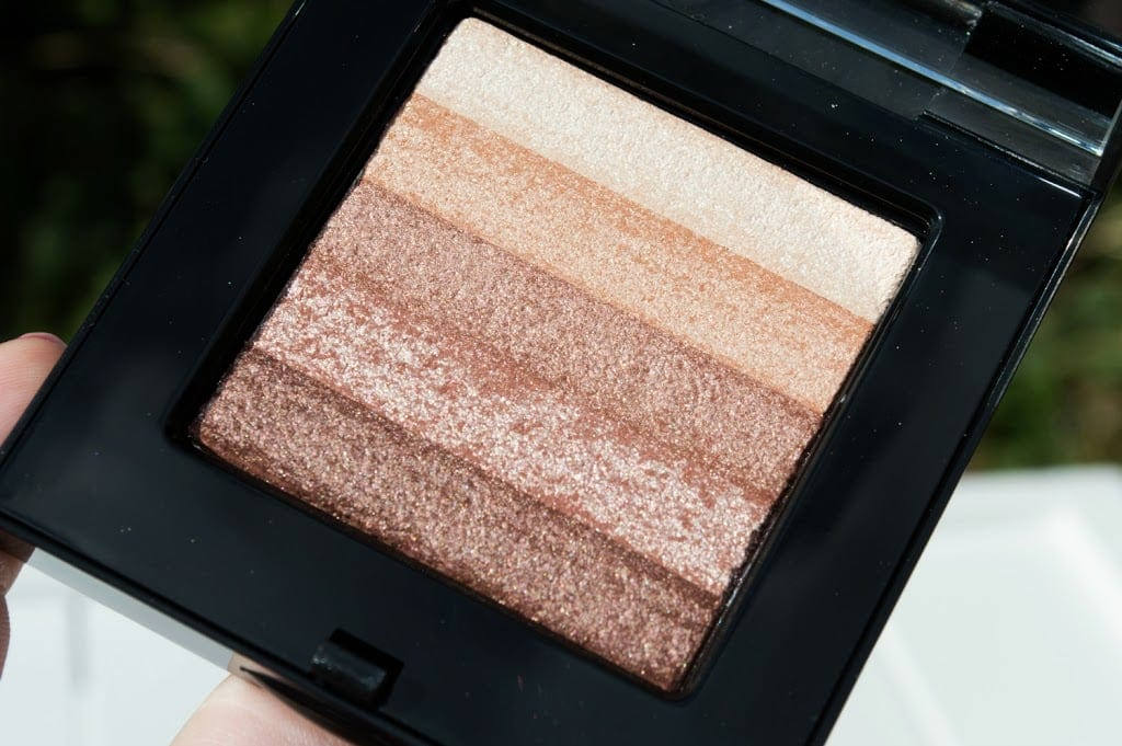 Close up image of the Shimmer Brick pan with five beautiful highlighter shades