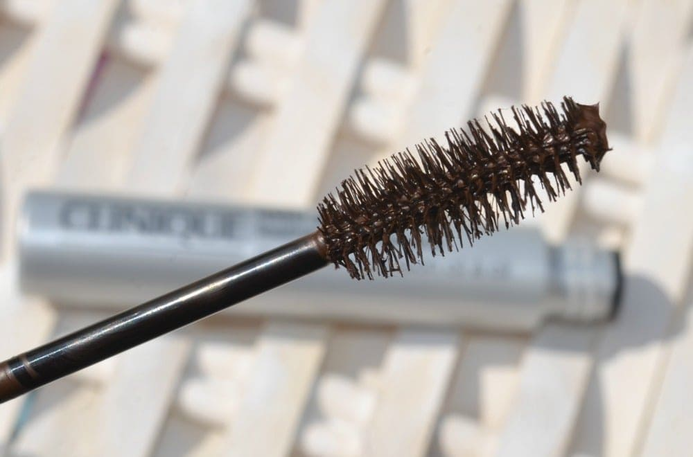 Close up image of the large, fluffy mascara wand with natural bristles