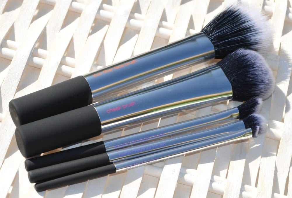 Image showing the five silver coloured makeup brushes laying on their side