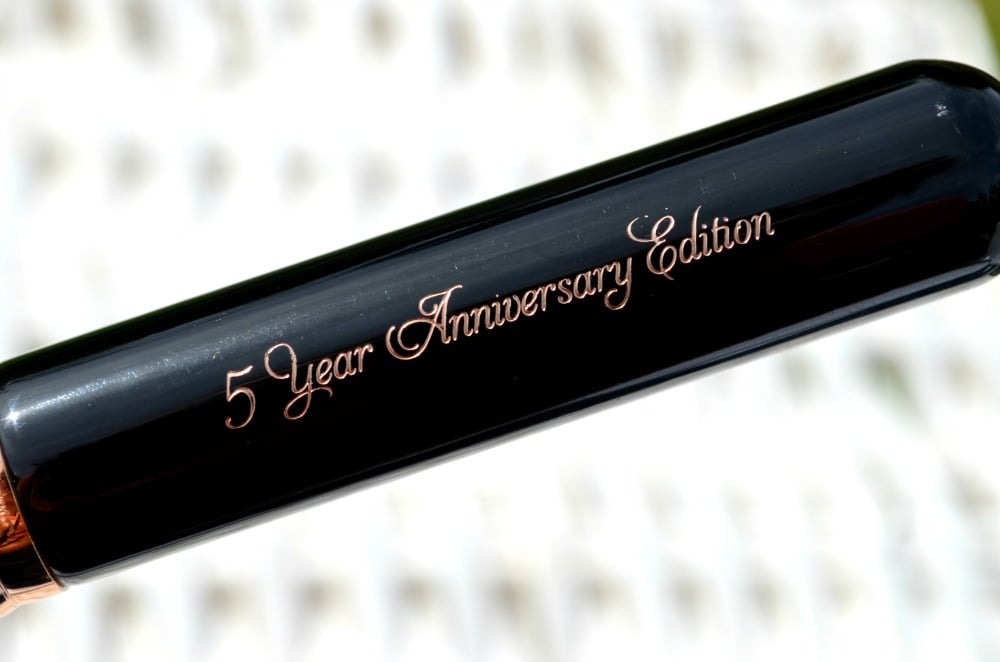 Close up image of the 5 year anniversary edition engraving in the wooden handle of the makeup brush