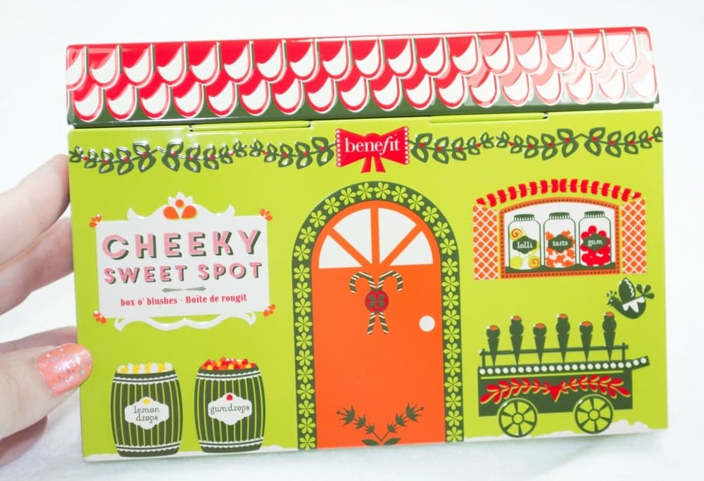 Image of the pretty green tin packaging with a sweet shop design