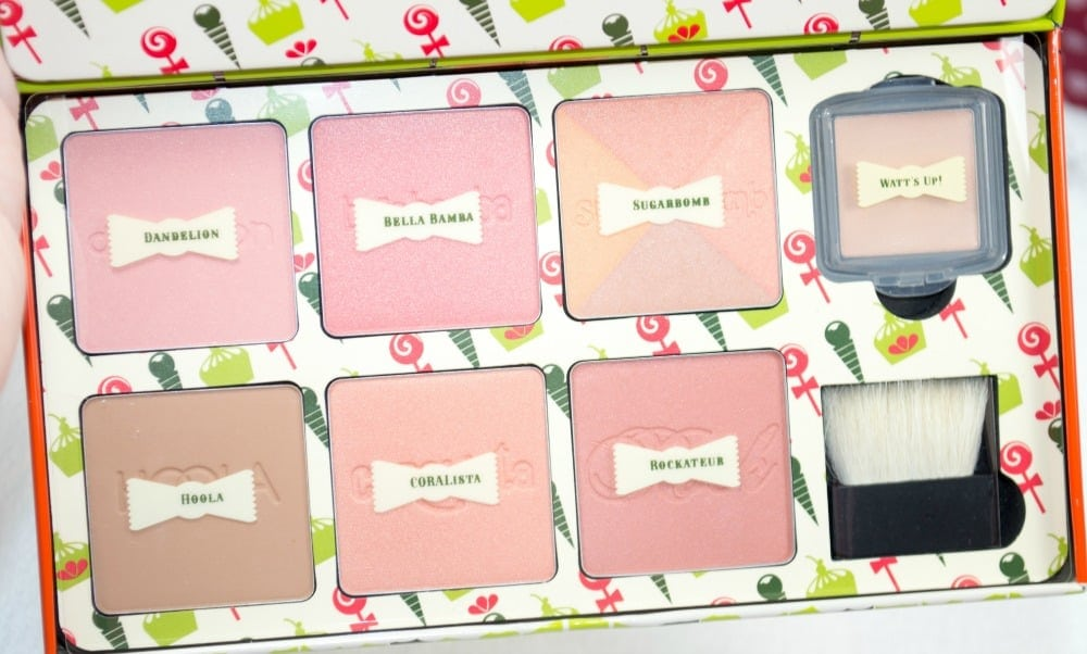 Close up of the six powders inside the palette, and the mini cream highlighter compact