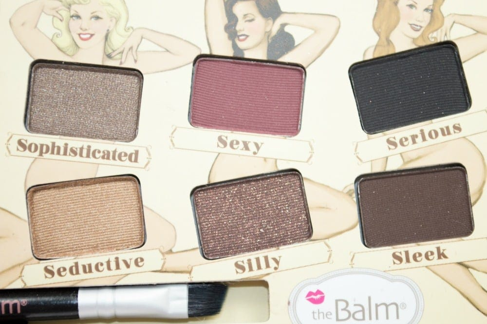 Close up of six eyeshadows - Sophisticated, sexy, serious, seductive, silly and sleek