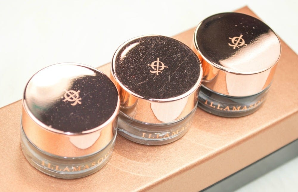 Image of three glass jars with rose gold plastic lids