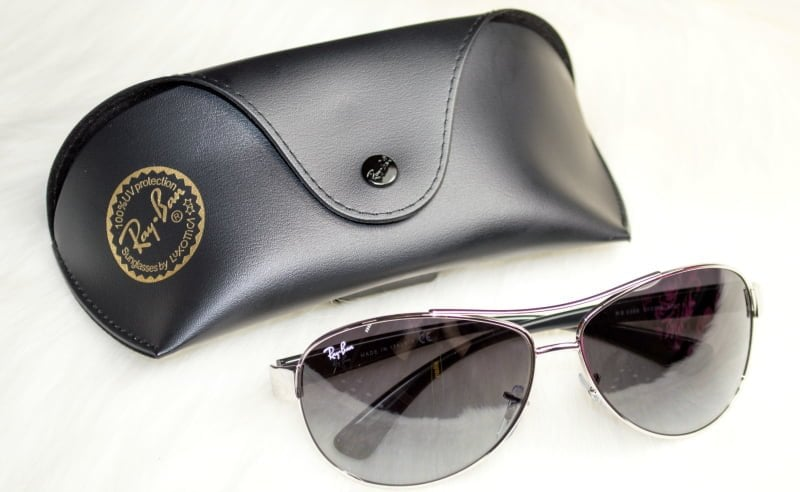 Image of the sunglasses laying next to their sunglasses case