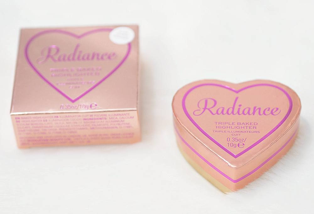 Review and Swatches of the I Heart Revolution Radiance Glow Hearts Highlighter - a triple baked highlighter in a glittery pale gold shade.`